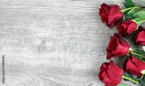Tuinposter Roses Beautiful Red Roses Still Life Over Rustic Wooden Background, Love Concept, Shot From Above