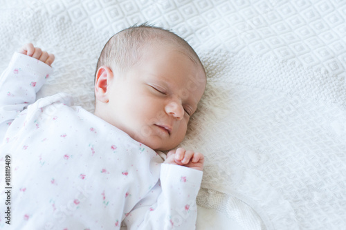a newborn has a healthy day's sleep. sweet dreaming. happy motherhood. copy space concept.