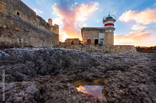 Fényképezés  The castle of Brucoli and the little lighthouse reflected in a puddle, Syracuse,