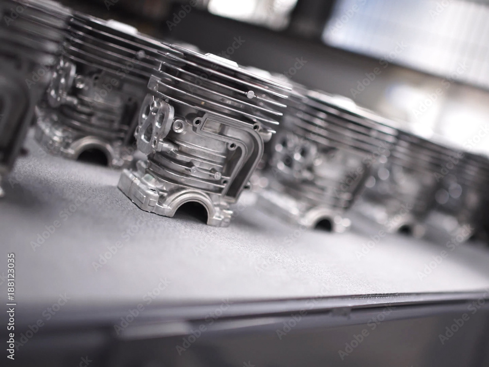 Fototapety, obrazy: Detail of aluminum castings in a motorcycle engine production line.