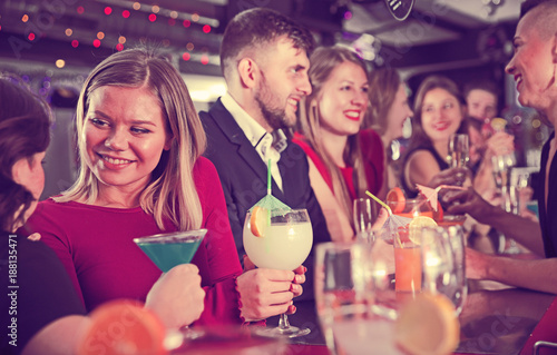 Fotografia  Girl with friends partying in bar