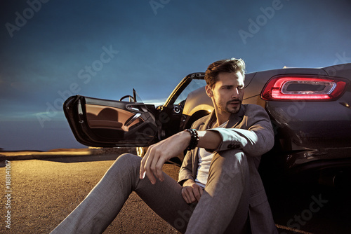 Poster Artist KB Handsome man leaning on the luxurious car