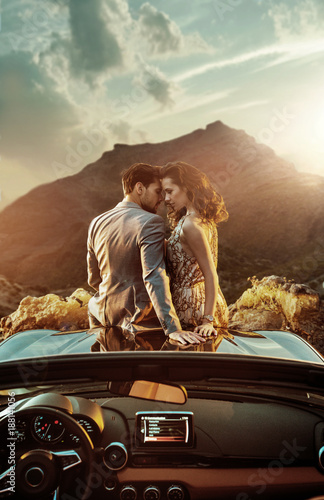 Fotobehang Artist KB Romantic couple sitting on the bonnet