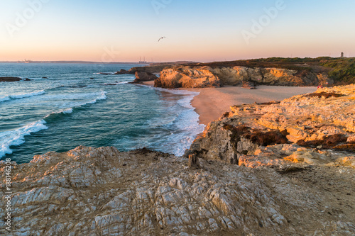 Sunset in beach with rocks in Porto Covo in Alentejo, Portugal Wallpaper Mural