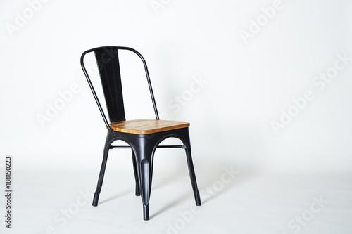 Steel chair with light wood Fototapeta