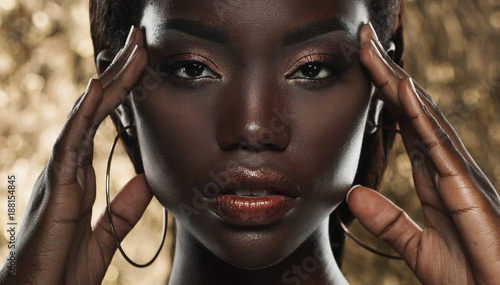 Photo  portrait of sensual young african woman against golden background