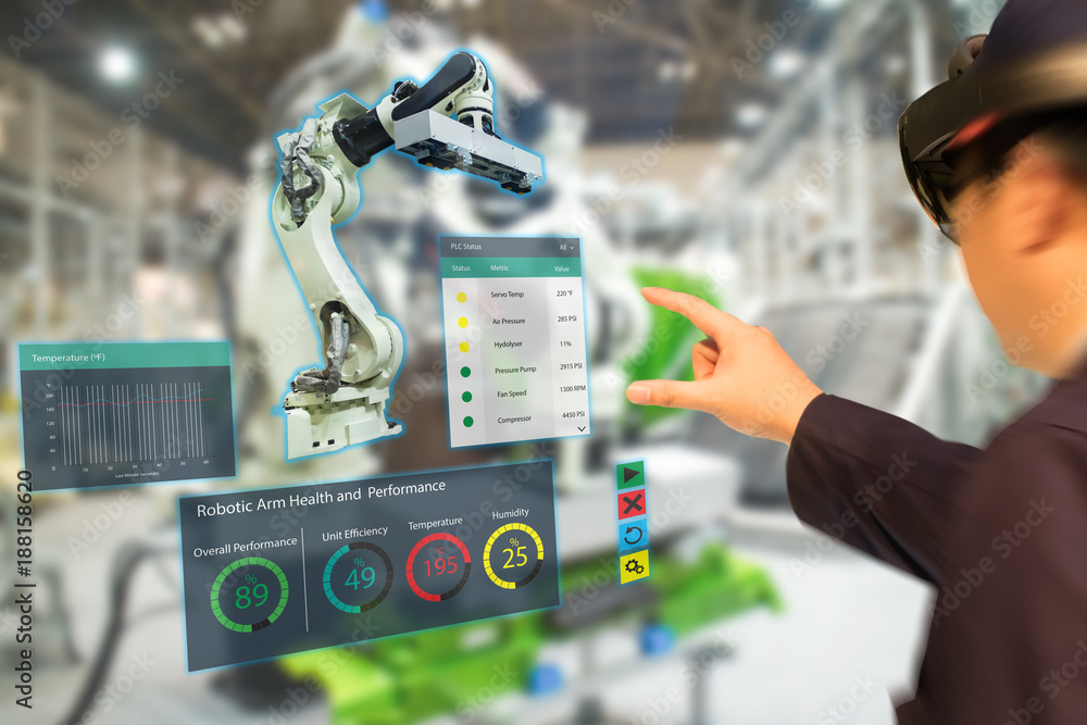 Fototapeta iot industry 4.0 concept,industrial engineer(blurred) using smart glasses with augmented mixed with virtual reality technology to monitoring machine in real time.Smart factory use Automation robot arm