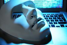 White Mask On Laptop Keyboard, Closeup