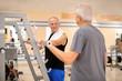 Elderly people in modern gym