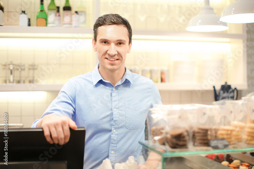 Fototapety, obrazy: Young man standing in store. Small business owner portrait