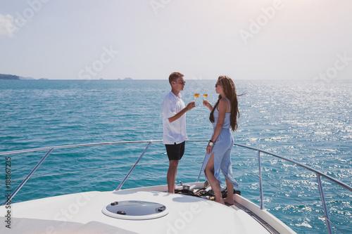 couple drinking champange on luxury yacht on cruise, luxurious lifestyle