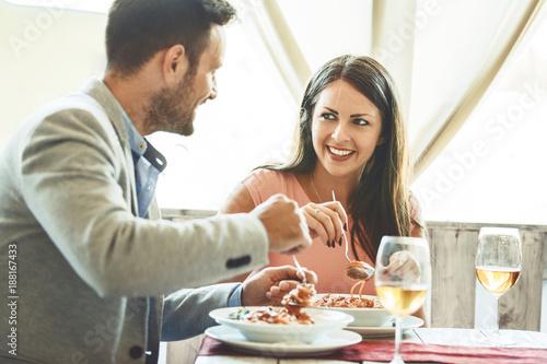 Fotobehang Restaurant Couple enjoying pasta