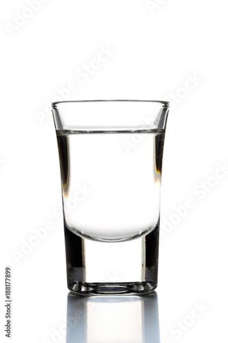 Fotografija German hard liquor Korn Schnapps in shot glass