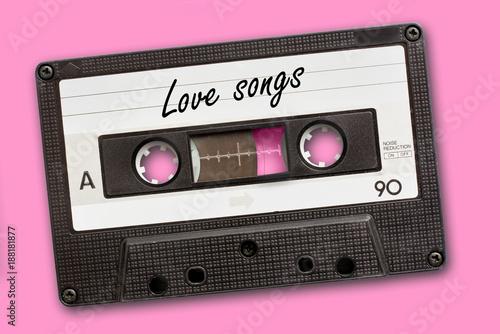 Love songs written on vintage audio cassette tape, pink background Billede på lærred