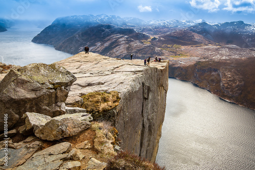 Wall Murals Northern Europe Groups of tourist standing on edge of Pulpit rock (Preikestolen)
