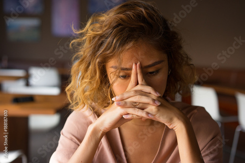 Fotografía  Tired Young Woman Leaning Head on Hands