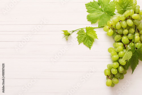 green grape on white wooden background