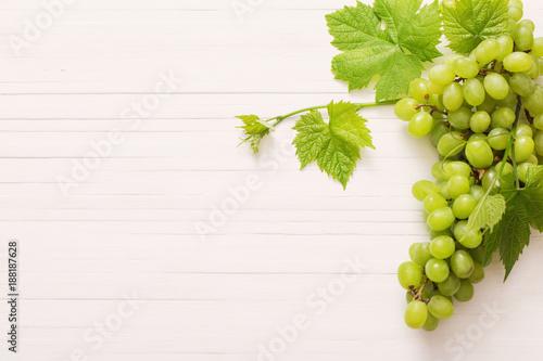 Fototapeta green grape on white wooden background obraz