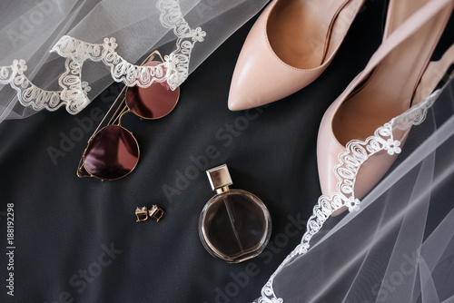 Fototapeta Wedding accessories. Bouquet and accessories of bride and groom. Wedding details obraz