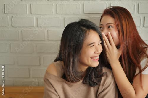 Fotografie, Obraz  woman gossiping, whispering, listening to positive rumor or hearsay