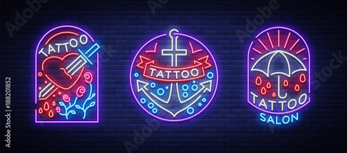 Tattoo parlor set of logos in neon style Canvas Print