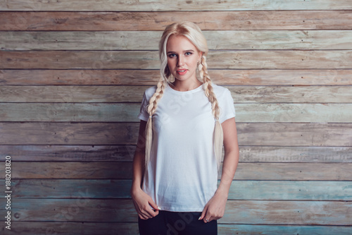Fotografie, Obraz  Beautiful girl with two braids in a white T-shirt. Mock-up.