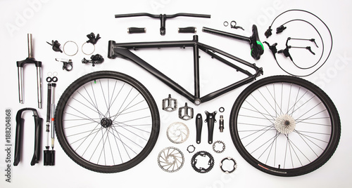 top view still life of bicycle parts, and equipment on the white