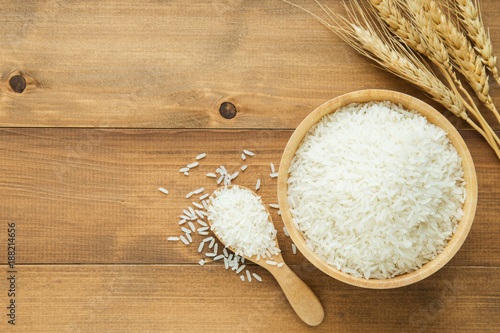 Fotografija white rice (Thai Jasmine rice) in wooden bowl on wood background with copy space