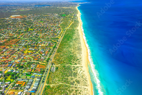 Aerial view of Scarborough Beach at coastal suburb of Perth, Western Australia, located approximately 14 km northwest of the city center. Scenic flight over the shoreline and the coral coast.