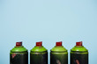 canvas print picture close up view of arranged cans with aerosol paint isolated on blue
