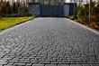 canvas print picture - Cobblestone entrance in the garden, graphite paving stone texture, pavement