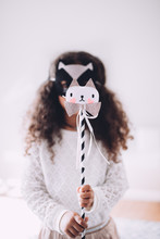 Cute Little Girl In Cat Costume At Party