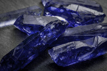 Sapphires And Raw Crystal Gems Concept With Closeup Of A Bunch Of Blue Uncut Sapphire Crystals
