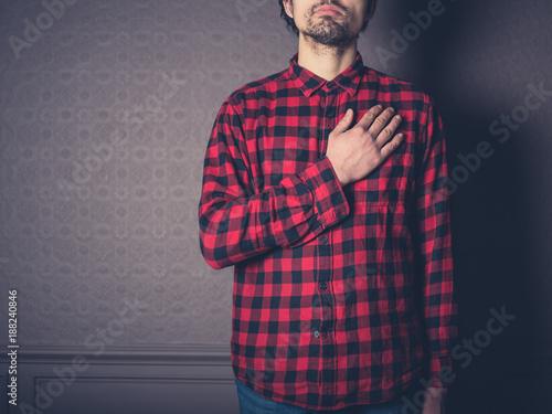 Man in red shirt swearing allegiance Canvas Print