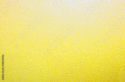 Yellow textured background. Bright cheerful pastel yellow, perfect for springtime, summer or Easter theme.