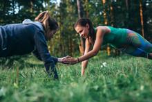 Two Girls Doing Buddy Workout ...