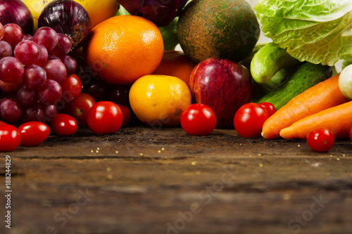 Fresh vegetable and fruit on wood desk at kitchen prepare for cook by chef. vegetarian, salad bar, healthy food and fresh food concept. © piyaset