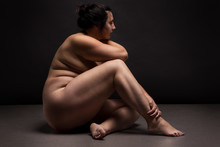 Obese Nude Woman Doing Yoga Exercise. Workout Concept.