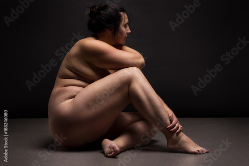 Poster Akt Obese nude woman doing yoga exercise. Workout concept.