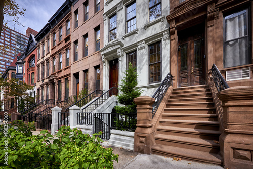 Fotografie, Obraz  a row of colorful brownstone buildings