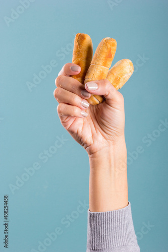 woman's hand holding cheese fingers