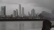 Woman contemplating polluted city on rainy day, Panama city. 4k
