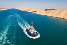 Tugboat Behind A Cruise Ship On Suez Canal, Egypt