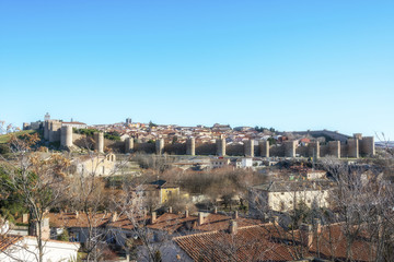 Fototapeta na wymiar Panoramic view of the historic city Avila with its famous medieval town walls surround at the sunny winter day, Spain