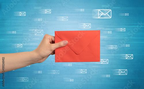 Valokuva  Hand holding envelope with message symbols around