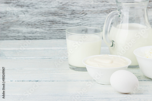 Staande foto Zuivelproducten Different dairy products, white wooden background