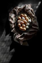 Eggs In A Basket On A Dark Bac...