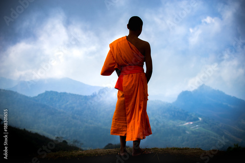 The young monk standing over landscape in Thailand. Canvas