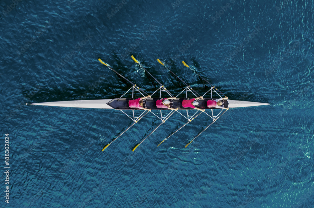 Fototapety, obrazy: Women's rowing team on blue water