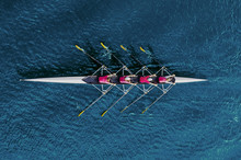 Women's Rowing Team On Blue Wa...